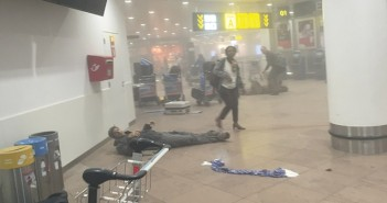 BRUSSELS, BELGIUM - MARCH 22:  (EDITOR'S NOTE: Original raw image shot on a mobile phone) An injured man lies amongst debris following a suicide bombing at Brussels Zaventem airport on March 22, 2016 in Brussels, Belgium. Georgian journalist Ketevan Kardava, special correspondent for the Georgian Public Broadcaster, was travelling to Geneva when the attack took place, she was knocked to the floor and began to take photographs in the moments that followed. At least 31 people were killed and more than 260 injured in a twin suicide blast at Zaventem Airport and a further bomb attack at Maelbeek Metro Station. Two brothers are thought to have carried out the attacks and a manhunt is underway for a third suspect.   (Photo by Ketevan Kardava/Getty Images)