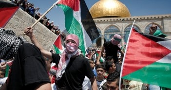 "Palestinians wave national flags as they demonstrate on the Al-Aqsa mosque compound in the Old City of Jerusalem, on May 15, 2015, to mark the 67th anniversary of the ""Nakba"". ""Nakba"" means in Arabic ""catastrophe"" in reference to the birth of the state of Israel 67-years-ago in British-mandate Palestine, which led to the displacement of hundreds of thousands of Palestinians who either fled or were driven out of their homes during the 1948 war over Israel's creation. AFP PHOTO / AHMAD GHARABLI / AFP / AHMAD GHARABLI"