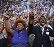 PHILADELPHIA, PA - JULY 28: Delegates stand and cheer as Reverend William Barber delivers a speech on the fourth day of the Democratic National Convention at the Wells Fargo Center, July 28, 2016 in Philadelphia, Pennsylvania. Democratic presidential candidate Hillary Clinton received the number of votes needed to secure the party's nomination. An estimated 50,000 people are expected in Philadelphia, including hundreds of protesters and members of the media. The four-day Democratic National Convention kicked off July 25. (Photo by Chip Somodevilla/Getty Images)