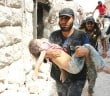 A Syrian man carries a wounded child following a barrel bomb attack on the Bab al-Nairab neighbourhood of the northern Syrian city of Aleppo on August 25, 2016.  At least fifteen civilians, among them eleven children were killed in a barrel bomb attack carried out by government forces on a rebel-held neighbourhood of Syria's Aleppo city, according to the Syrian Observatory for Human Rights. / AFP PHOTO / AMEER ALHALBI