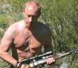 CROPPED VERSION - This pool picture provided 03 September 2007 shows Russian President Vladimir Putin carrying a hunting rifle in the Republic of Tuva, 15 August 2007. Putin is scheduled to visit Australia for the ASEAN conference starting this week.    AFP PHOTO /  RIA NOVOSTI / KREMLIN POOL / DMITRY ASTAKHOV / AFP PHOTO / RIA NOVOSTI / DMITRY ASTAKHOV