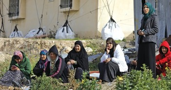 Bedouin women gather during a protest against home demolitions on January 18, 2017 in the Bedouin village of Umm al-Hiran, which is not recognized by the Israeli government, near the southern city of Beersheba, in the Negev desert. An Israeli policeman was killed while taking part in an operation to demolish homes in the Bedouin village, with authorities claiming he was targeted in a car-ramming attack. The driver was earlier reported shot dead by police as residents disputed the police version of events, saying the driver was heading to the scene to talk with authorities in an attempt to halt the demolitions. / AFP PHOTO / MENAHEM KAHANA