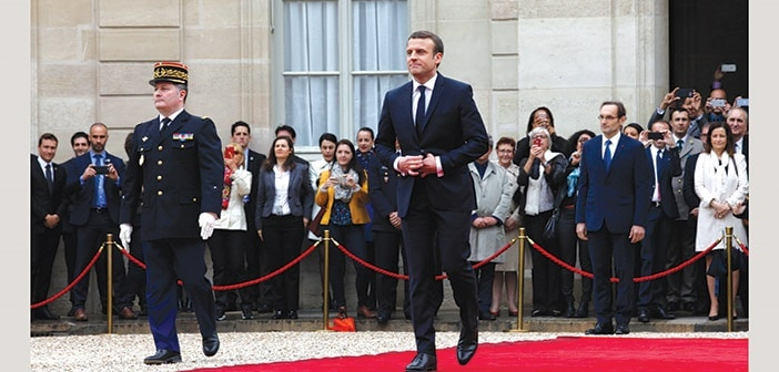 French newly elected President Emmanuel Macron is welcomed by his predecessor Francois Hollande (up) as he arrives at the Elysee presidential Palace for the handover and inauguration ceremonies on May 14, 2017 in Paris.(Photo by Antoine Gyori/Corbis via Getty Images)