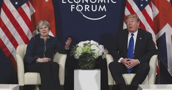 Theresa May, U.K. prime minister, left, and U.S. President Donald Trump, pose for photographs during a bilateral meeting on day three of the World Economic Forum (WEF) in Davos, Switzerland, on Thursday, Jan. 25, 2018. World leaders, influential executives, bankers and policy makers attend the 48th annual meeting of the World Economic Forum in Davos from Jan. 23 - 26. Photographer: Simon Dawson/Bloomberg via Getty Images